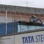 Workers use an elevated work platform at the Tata Steel plant in Motherwell